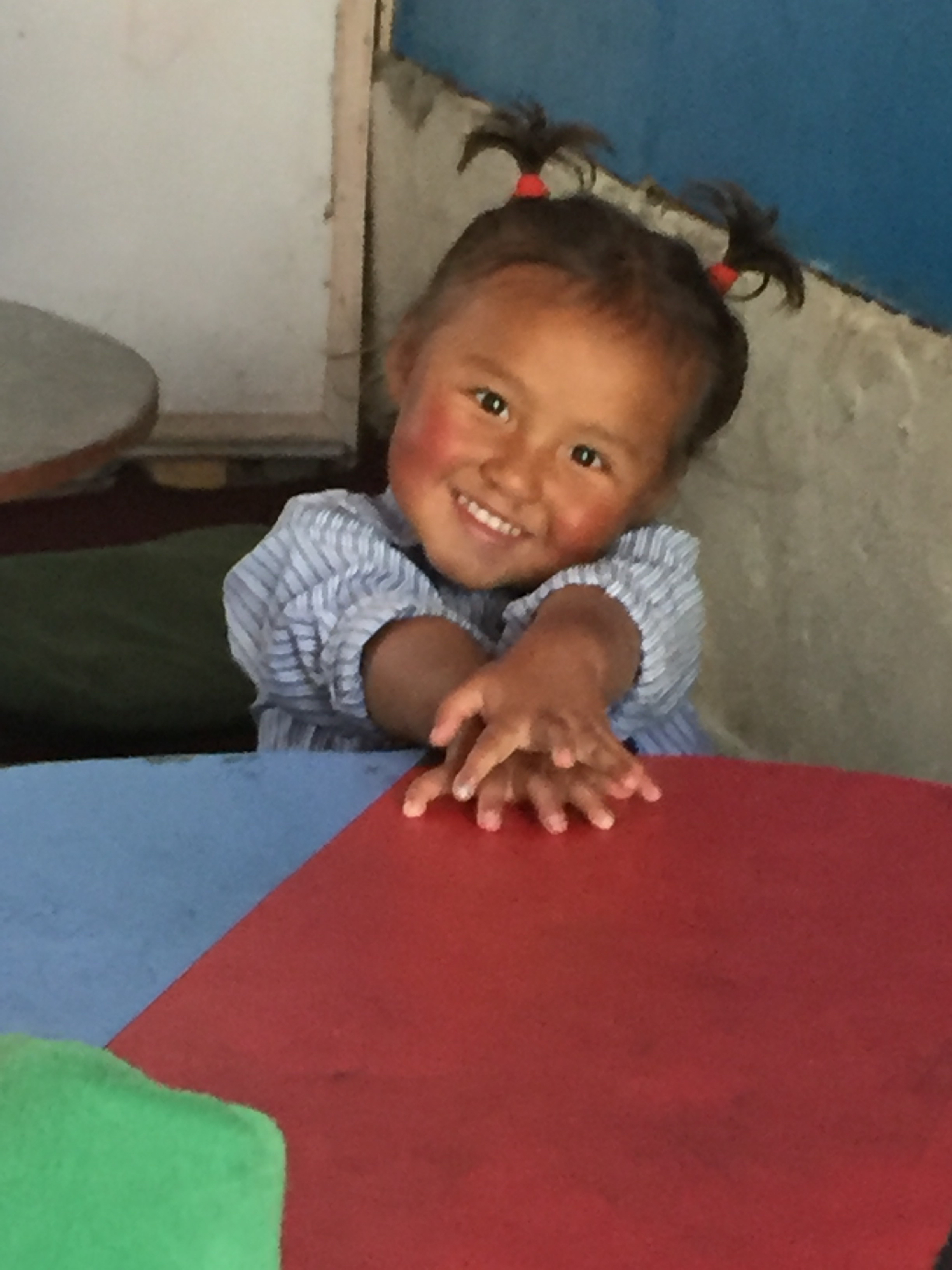 Young girl in Guranse classroom